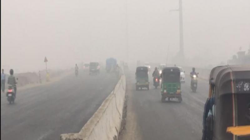 Air pollution levels in the national capital escalated to hazardous and visibility dropped significantly as a thick blanket of smog engulfed several parts of the city on Sunday morning. (Photo: ANI)