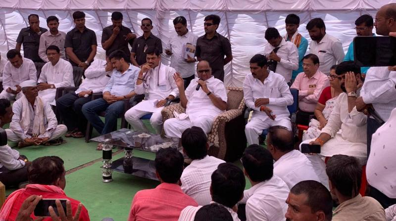 The former Union Agriculture minister also interacted with people from Khadkat village in Ashti taluka of the district. (Photo: Twitter/ @PawarSpeaks)