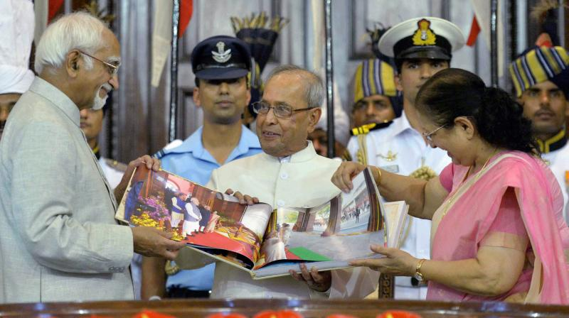 President Pranab Mukherjee is presented a coffee-table book by Vice President Hamid Ansari and Lok Sabha Speaker Sumitra Mahajan during his farewell ceremony in the Central Hall of Parliament in New Delhi on Sunday. (Photo: PTI)