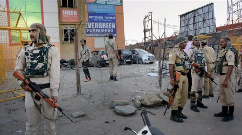 Security forces stand guard after a grenade attack by militants at Jehangir Chowk in Srinagar on Thursday. (Photo: PTI)