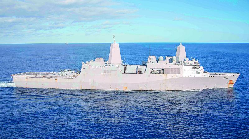 A handout picture released by the US NAVY on December 24, 2018, shows the San Antonio-class amphibious transport dock ship USS Arlington (LPD 24). (Photo - AFP)