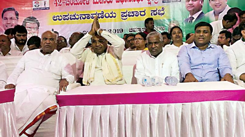 Senior Congress leaders M. Mallikarjun Kharge and Siddaramaiah campaign for Party candidate in Chincholi on Saturday. (Photo - DC)
