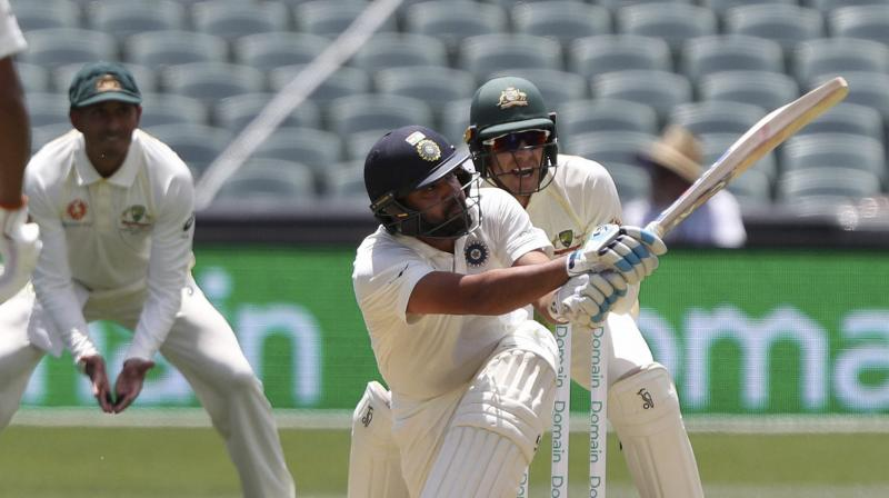 While Pujara was sedate at one end, Rohit took the lead in scoring as he hit sixes at will. (Photo: AP)