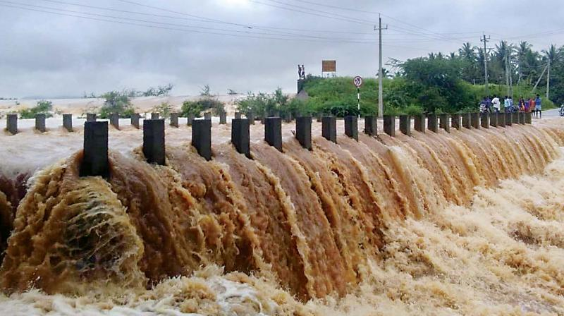 A bridge submerged near Tarikere as heavy rain continued to lash Chikkamagaluru district. (KPN)
