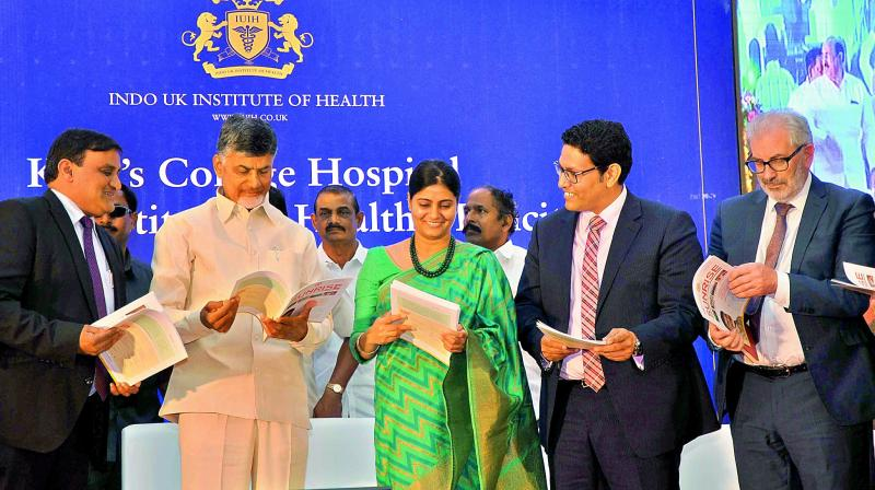 Chief Minister N. Chandrababu Naidu, Anupriya Patel, Minister for Health and Family welfare, Dr. Ajay Rajan Gupta, CEO and MD, Indo-UK Institute release a book during the foundation ceremony.
