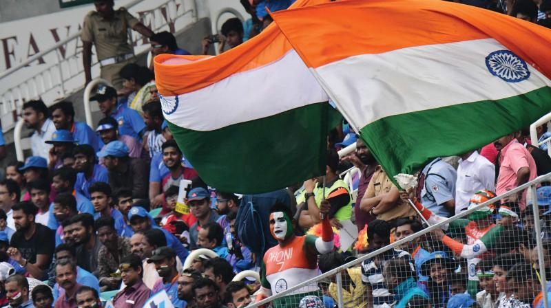 Cricket fans enjoy the India-West Indies fifth  and final one-day match at the Sports Hub stadium at Karyavattom in Thiruvananthapuram on Thursday . A.V. MUZAFAR