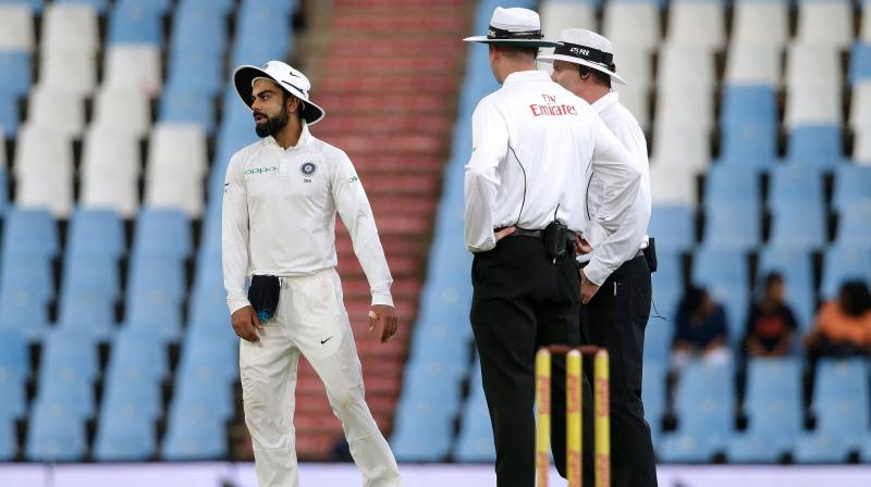 """""""Monday's incident happened in the 25th over of South Africa's second innings when Kohli continued to complain to umpire Michael Gough about the ball being affected by a damp outfield following a rain delay, before throwing the ball into the ground in an aggressive manner,"""" said ICC in its media release. (Photo: AFP)"""