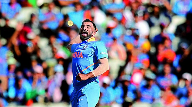 Mohammed Shami celebrates taking a wicket in India's group stage match against the West Indies on Thursday. (Photo: AP)