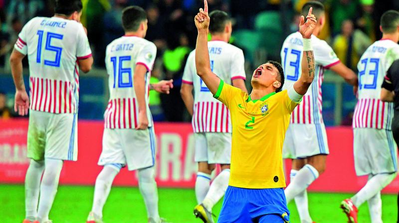 Brazil's Thiago Silva celebrates after defeating Paraguay in penalty shootout in the Copa America quarterfinals in Porto Alegre, Brazil, on Friday. (Photo: AFP)