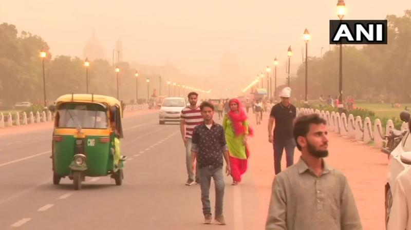 A dust storm hit several parts of the national capital Wednesday evening, following which a thick haze was hanging over the city, affecting visibility. (Photo: ANI)