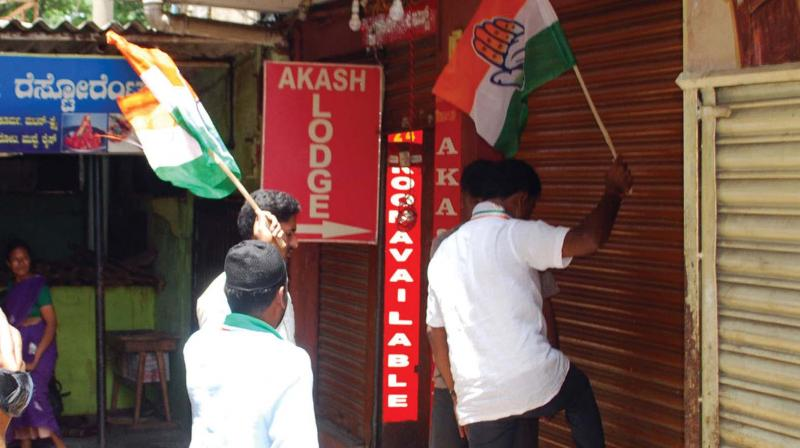 Congress workers forcibly shutting shops in  Mandya.
