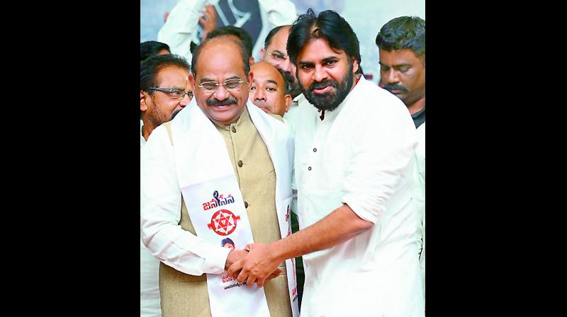 Rajahmundry BJP MLA Akula Satyanarayana joins Jana Sena in the presence of party president Pawan Kalyan at state office in Vijayawada on Monday. (Photo: DC)