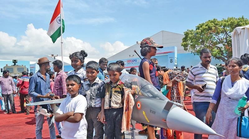 Children pose in front  of a flight model on display.  (Photo:DC)