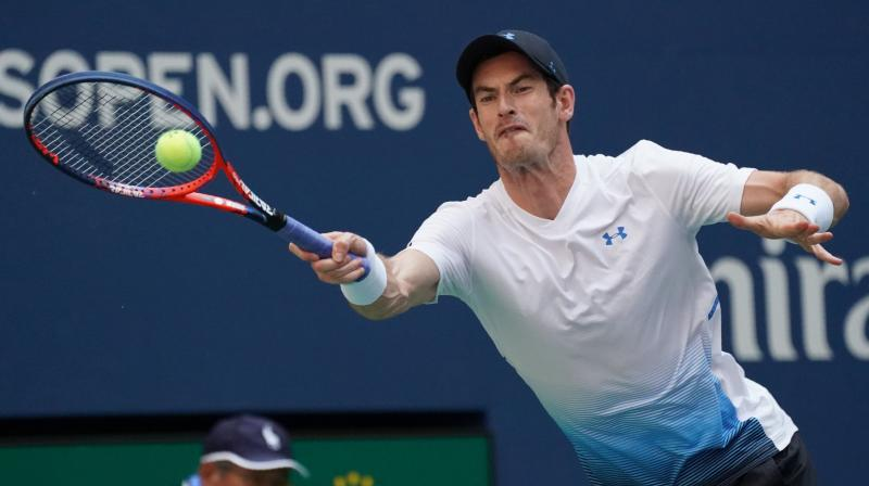 Murray said the shadows cast in the massive Arthur Ashe Stadium provided a slight respite from sweltering temperatures. (Photo: AFP)