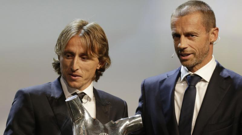 Real Madrid's achievement in winning the Champions League for the third season running was further recognised as Modric also won the UEFA award for the best midfielder of last season. (Photo: AP)