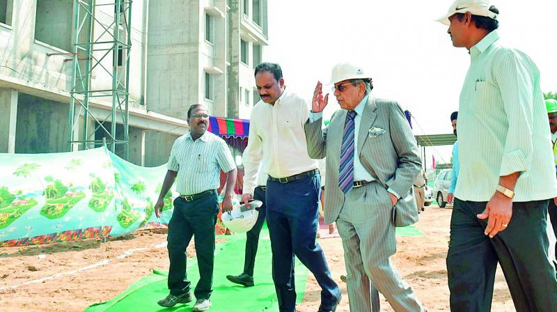 15th Finance Commission chairman N.K. Singh and his team members visit the housing complexes in the capital region along with APCRDA commissioner Ch. Sreedhar on Friday.  (DC)