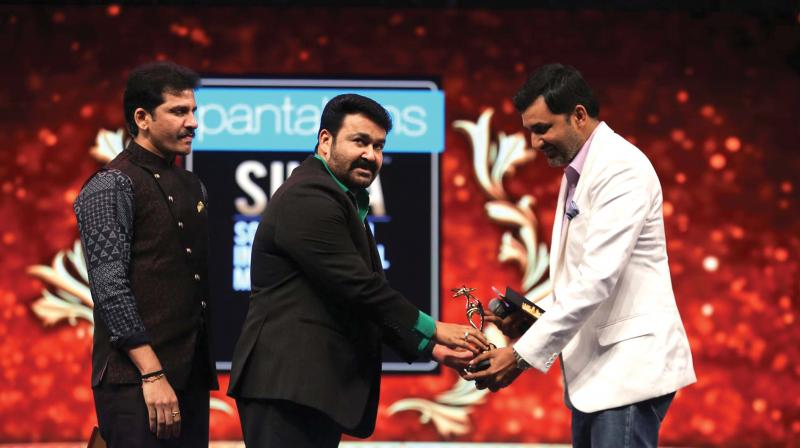 He received two awards – one, for himself, the Most Popular Star in the Middle East, and the other, on behalf of his son Pranav, the best debutant actor in Malayalam.