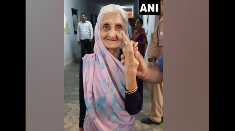 Senior citizens and first-time voters stole the show with their enthusiasm as they arrived at different polling stations to cast their valuable votes. (Photo: ANI)