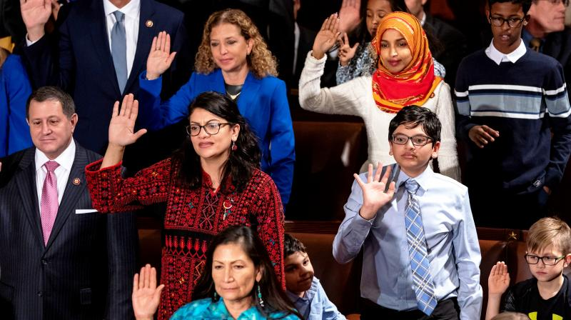 Tlaib (centre left) proudly wore her thobe to her historic swearing-in as the first Palestinian American member of Congress. (Photo: AP)
