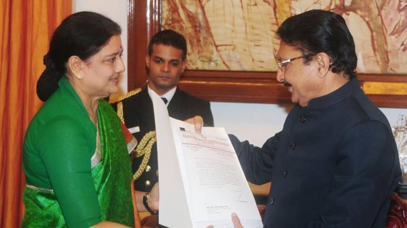 AIADMK general secretary VK Sasikala presents list of MLAs to Governor Ch Vidyasagar Rao. (Photo: DC)