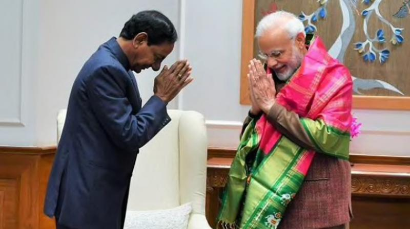 TRS chief and Telangana Chief Minister K Chandrashekar Rao met Prime Minister Narendra Modi on Wednesday in New Delhi. (Photo: ANI)