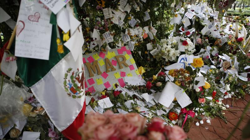 It is part of a process of grieving, paying homage to the victims and the first responders who toiled for days to rescue survivors. (Photo: AP)