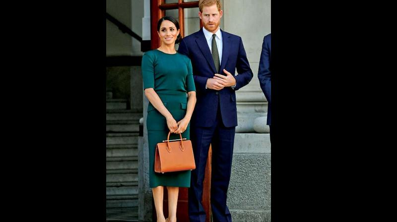 Meghan Markle with a structured handle bag