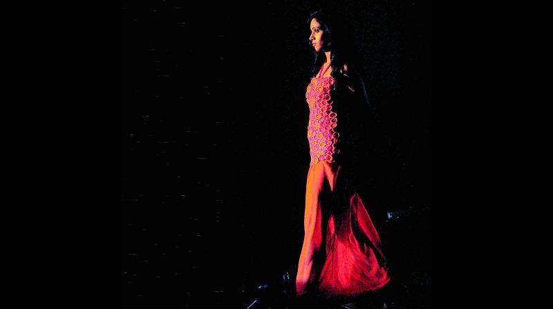 A model walks the ramp, showcasing a  student designer's condom-wear outfit at a fashion show in Mumbai. (Photo: AFP)