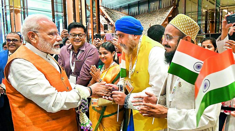 Prime Minister Narendra Modi being welcomed by Indian community in Bangkok on Saturday. (Photo: AP)