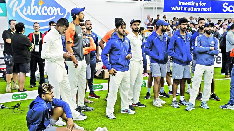 Members of Team India look dejected during the  post-match ceremony.     Image: AP