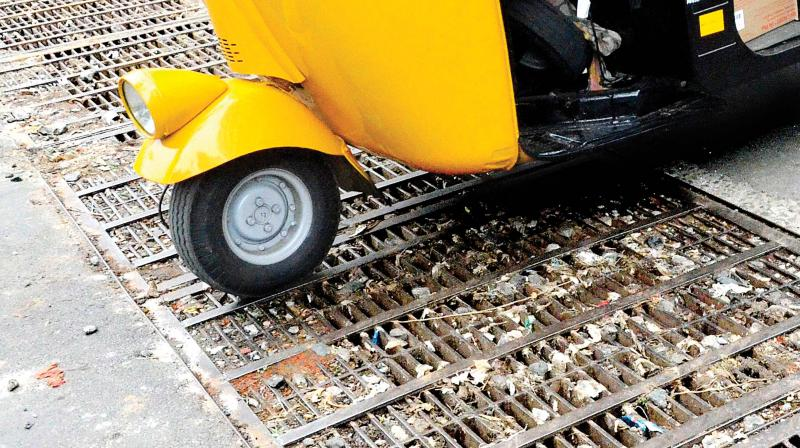 Clogged by stones, plastic and paper waste, most of the rain water vents to the drainage were blocked which resulted in instant flooding in different parts of the city. (Photo: Peethambaran Payyer)