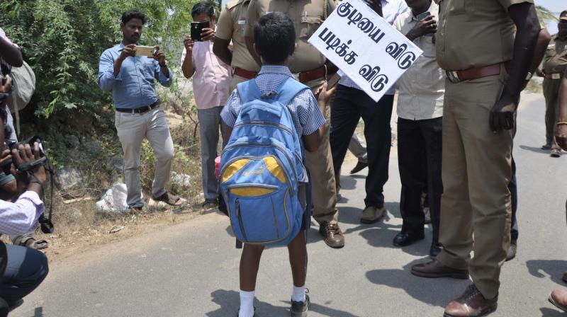 David and Goliath: Kid Aakash confronts Inspector Govindaraj, April 19. (File photo)