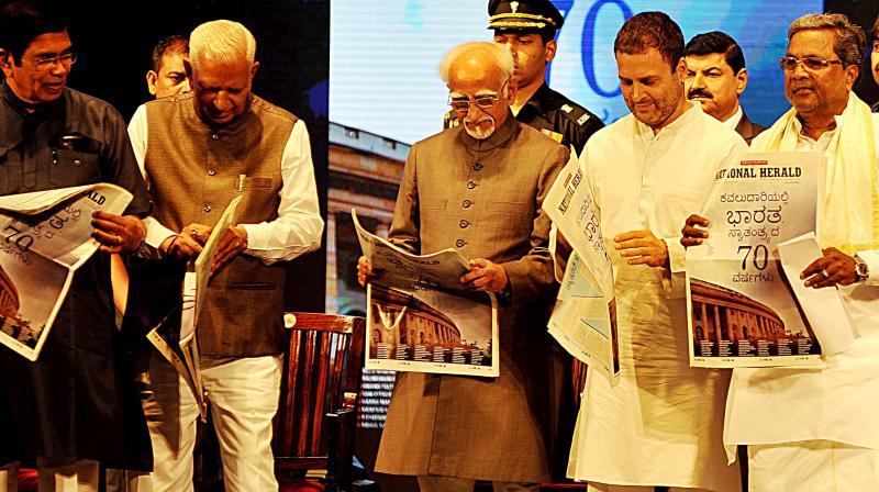 Congress leaders Oscar Fernandes, Rahul Gandhi, Siddaramaiah with Vice-President Hamid Ansari and Governor Vajubhai Vala at the re-launch function. (Photo: DC)