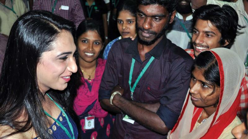 Actor Anjali Ameer interacts with youngsters after inaugurating the short-film fest organised by Oriental Film Society in Kozhikode on Thursday. (Photo: DC)