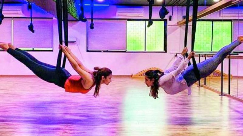 Actress Alia Bhatt, who was recently seen trying out aerial yoga with her friend Akansha Ranjan Kapoor, posted a picture on social media captioned 'Try, try until you fly'