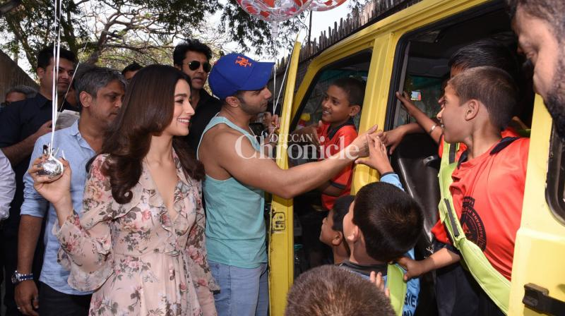 Varun Dhawan and Alia Bhatt visited an orphanage in Mumbai on the occasion of Valentine's Day and had an enjoyable time with them. (Photo: Viral Bhayani)