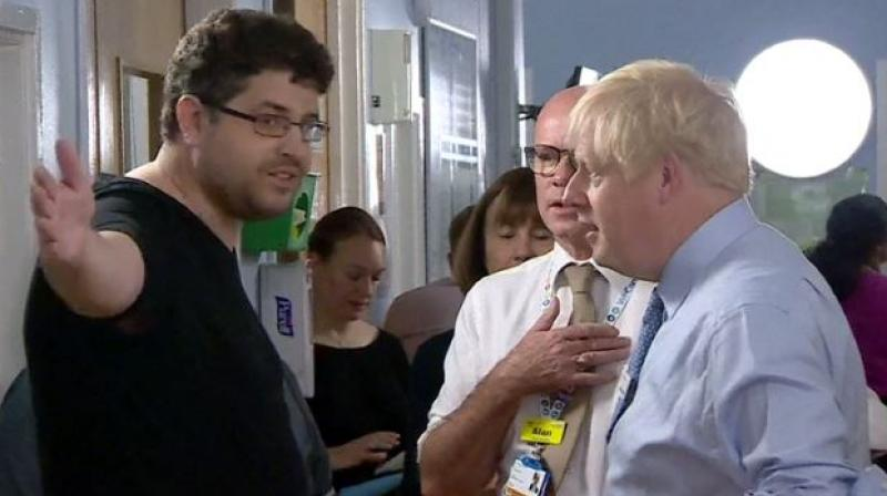 Boris Johnson confronted by emotional father of sick patient over NHS cuts