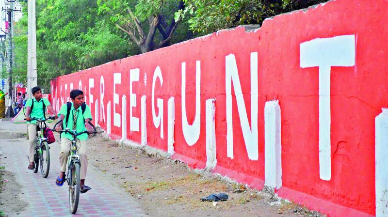 Guntur city turns poster-free with the initiative of the GMC and a few NGOs. The wall painting is attracting the people in the city. (Photo: DC)
