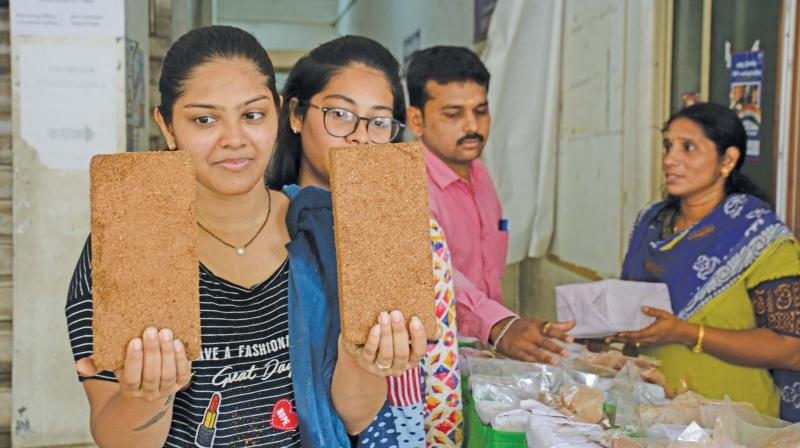 Visitors look at the organic combo pack being sold by the Chennai corporation at the RDC (North) office. Each pack,  priced at `100,  offers a grow bag, manure, coco peat, cow dung and red sand to be used for gardening purpose. (Photo - DC)