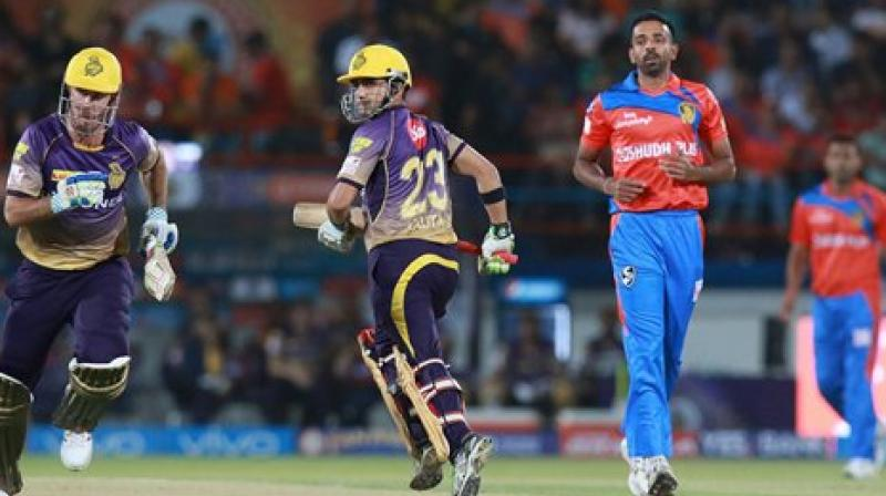 Kolkata Knight Riders captain Gautam Gambhir with Chris Lynn take a run during match 3 of the Vivo 2017 Indian Premier League against Gujarat Lions at the Saurashtra Cricket Association Stadium in Rajkot on Friday. (Photo: PTI)
