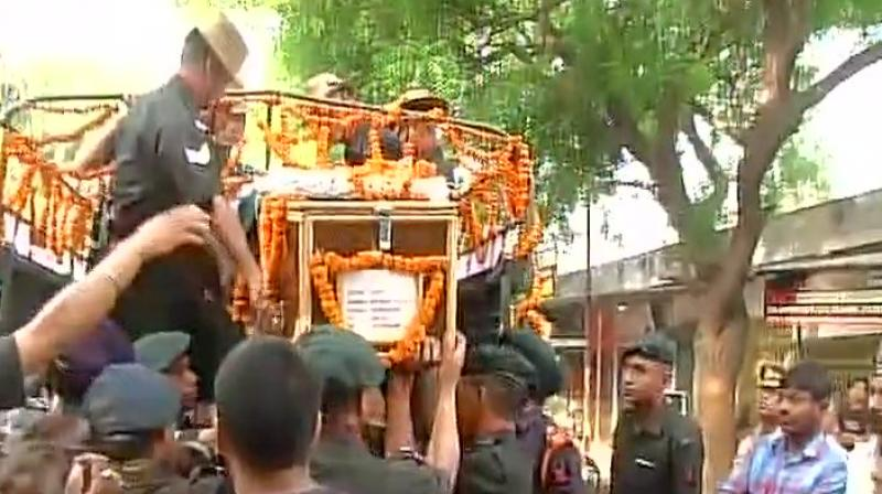 From the captain's residence, the mortal remains were taken to Sidhnath Ghat in a truck where he was cremated with full military honours. (ANI Twitter)