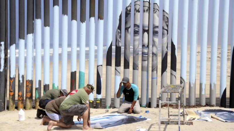 The mural celebrates the history of immigrants who were deported. (Photo: AP)