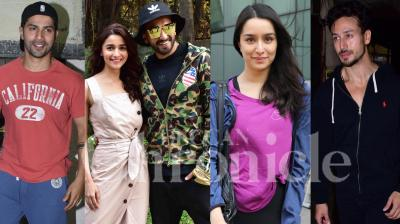 Bollywood stars Tiger Shroff, Varun Dhawan, Shraddha Kapoor, 'Gully Boy' couple Ranveer Singh and Alia Bhatt were spotted in the city. Check out the latest pictures here. (Photos by Viral Bhayani)