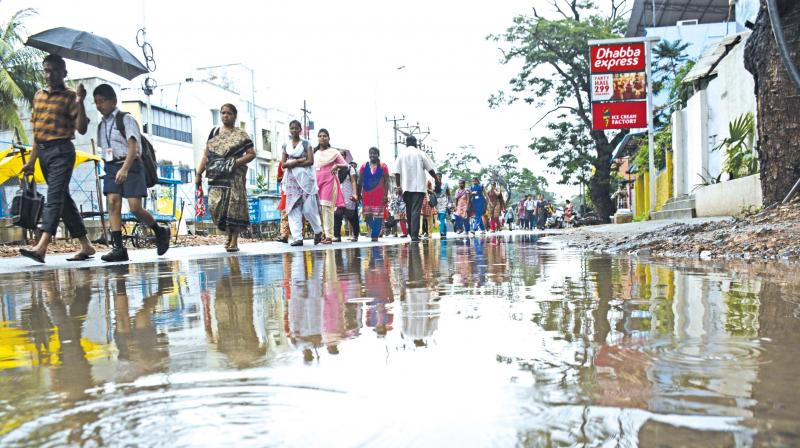 Heavy rains lashed parts of the city following a trough of low pressure over the Bay of Bengal on Tuesday. (Photo: DC)