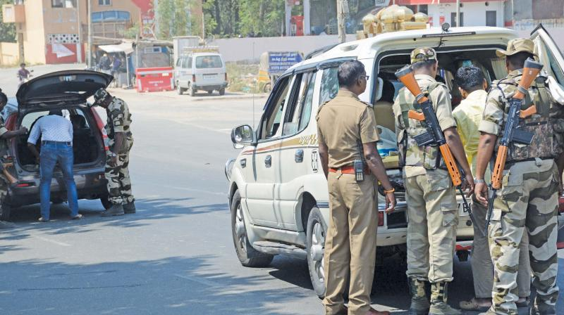CISF personnel checking vehicles at Korukkupet ahead of LS elections. (Photo: DC)