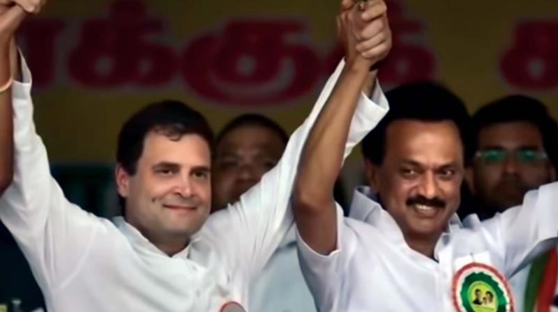 Surprisingly, the DMK version takes a jibe at Rahul Gandhi's parivar too.