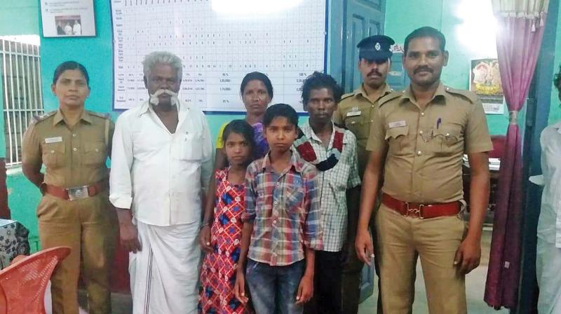 Kidnapped minor boy Madesh (standing in forefront and draped in checked shirt and jeans trouser) reunited with his family. (Photo:DC)