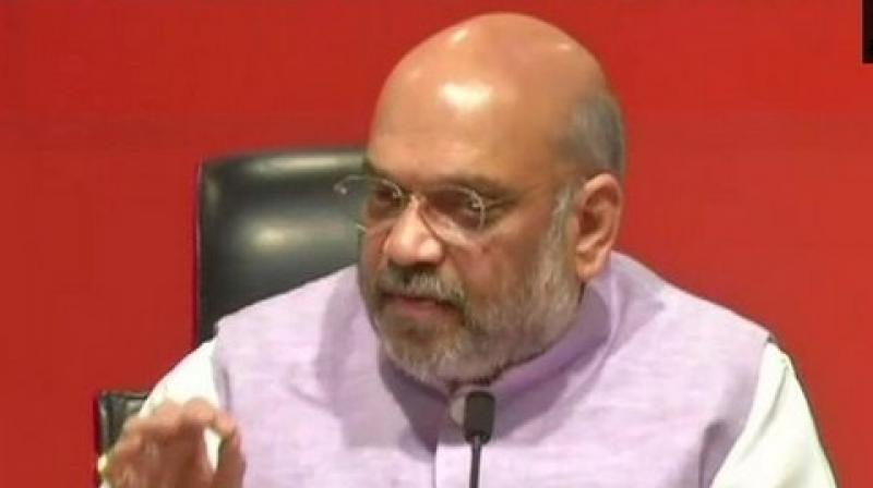 Shah said it was the relentless efforts of the party workers which strengthened the BJP at every booth of the country. (Photo: ANI twitter)