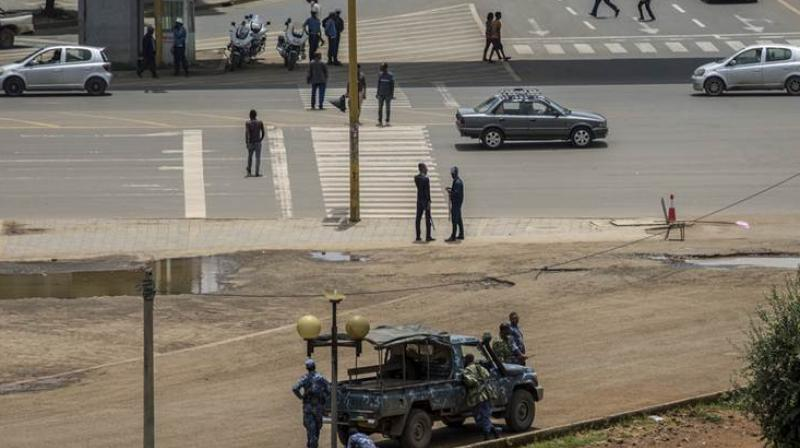 Security forces stand guard in Meskel Square in central Addis Ababa, Ethiopia Sunday. Ethiopia's government foiled a coup attempt in a region north of the capital and the country's military chief was shot dead. (Photo: AP)