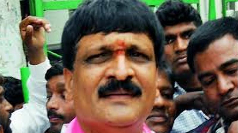 Mynampally became angry with Dolly Ramesh as he had left the TRS and joined the Congress. He pushed Ramesh from the stage and beat him up